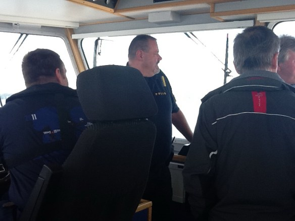Professional operators discussing boat handling onboard PTA 80.
