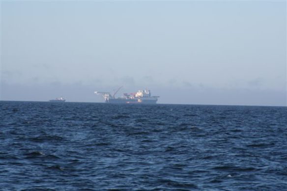 Sunday: 06:04 am, ships entering the natural gas pipeline, seen on our starboard side.